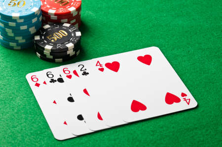 Three of a kind in poker with chips photo