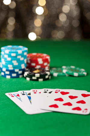 straight flush: Straight flush, with chips in front of a gold glitter background