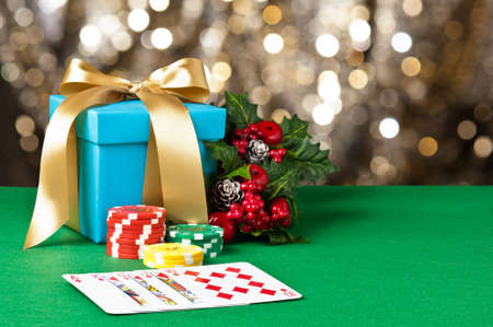 straight flush: Royal straight flush in Christmas setting with poker chips Stock Photo