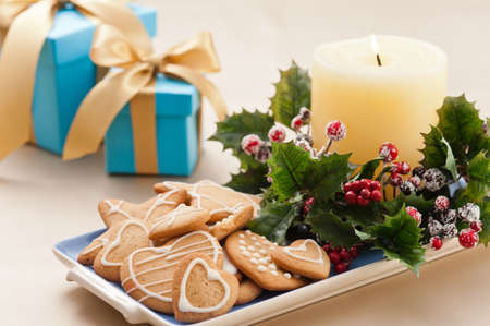 Christmas cookies, and presents in festive setting  photo