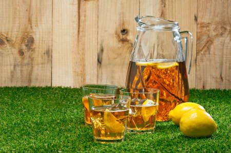 Iced Lemon Ice Tea in a summer setting photo