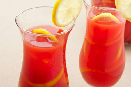 carafe: Chilled Orange Lemon Sangria with lemon decoration