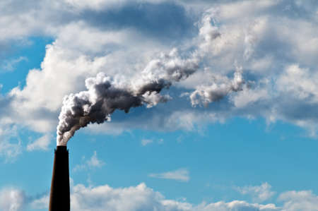 emissions: Chimney exhaust waste amount of CO2 into the atmosphere on a sunny day