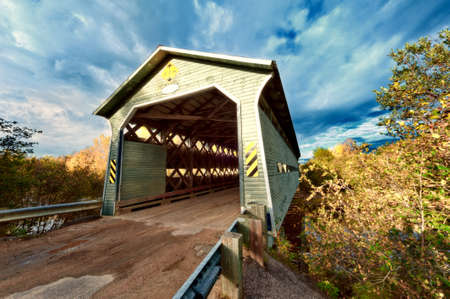 wooden covered bridge in New Brunswick Canada photo