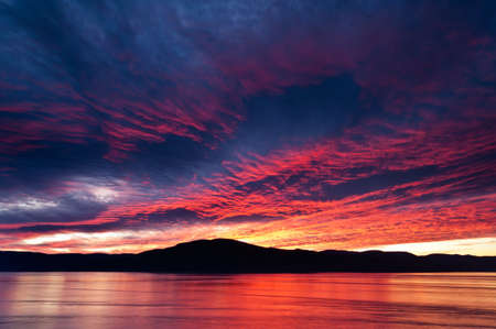 Amazing fiery burning evening sky beautiful blue reddish color range photo