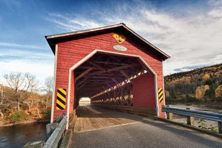 canada day: Wooden covered bridge in New Brunswick Canada Editorial