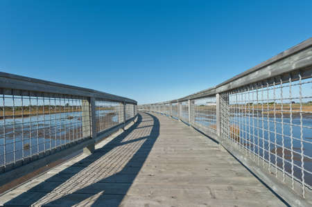 Elevated walkway above a salt marsh during a sunny day Stock Photo - 16867814
