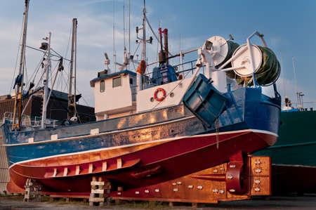 Fish trawler on land during off peak season, ship goes through maintenance Stock Photo - 16947041