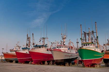 Fish trawler on land during off peak season, ship goes through maintenance Stock Photo - 16947040