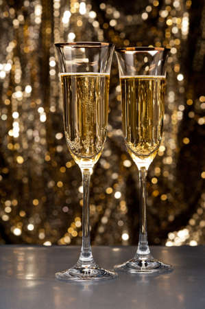 Champagne glasses in front of gold glitter background Stock Photo - 17165818