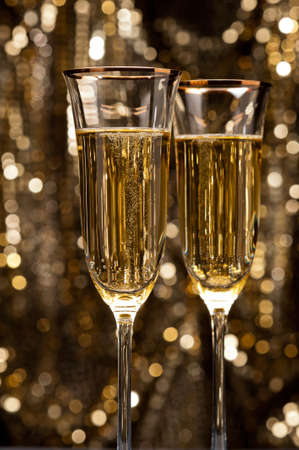Champagne glasses in front of gold glitter background Stock Photo - 17165777