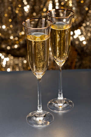 Champagne glasses in front of gold glitter background Stock Photo - 17165774