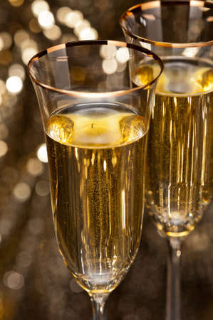 Champagne glasses in front of gold glitter background Stock Photo - 17165768