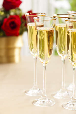 wedding reception decoration: Wedding reception setting with champagne and flowers