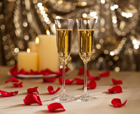 Gold glitter Wedding reception setting with champagne and candles photo