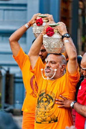 soulfulness: SINGAPORE, 2013 JANUARY 27  Devotees at the annual Thaipusam processionin Singapore  Hindu festival to worship and to make offerings to the god Muruga   2013 JANUARY 27