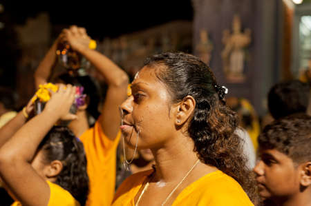 SINGAPORE, 2013 JANUARY 27  Female devotee at the annual Thaipusam procession, Singapore  Hindu festival to worship and to make offerings to the god Muruga   2013 JANUARY 27, EDITORIAL USE ONLY    Stock Photo - 17654296