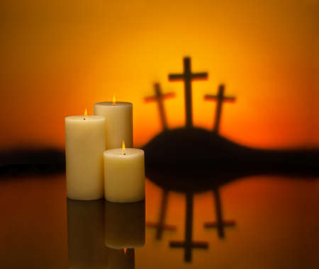 christian candle: Three crosses symbolic for Jesus crucifixion in Golgotha and candles of hope Stock Photo