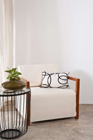 apartment living: Bright white armchair in a living room Stock Photo