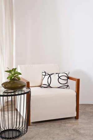 Bright white armchair in a living room Standard-Bild