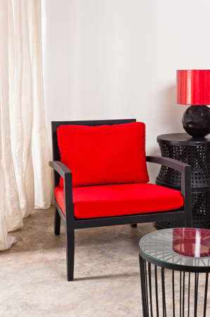 Black red Chair and side table in a bright setting photo