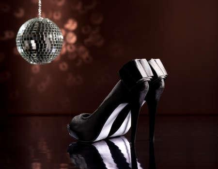 sexy woman disco: Beautiful black stilettos on the dance floor