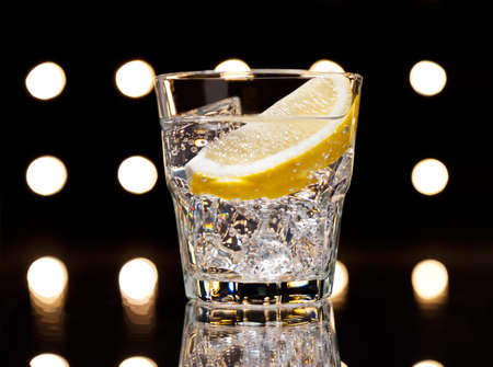 collins: Gin Tonic Tom Collins on the dance floor Stock Photo