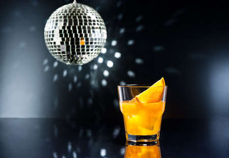 screw driver: screw driver cocktail in front of disco lights Stock Photo