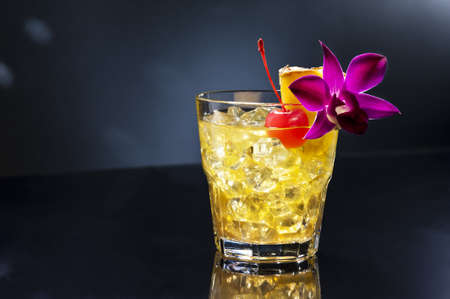 translates: Mai Tai translates from Tahitian to mean Out of this World. The Mai Tai was developed 1944, in the Oaklands Trader Vics. Victor Bergeron, put together this great drink. Stock Photo