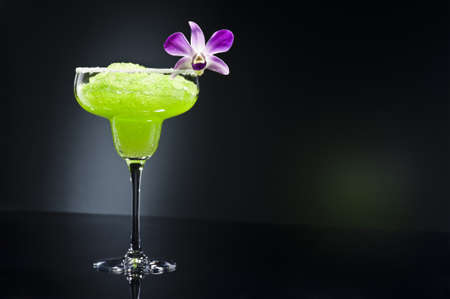 margarita:  Green margarita cocktail with orchid flower Stock Photo