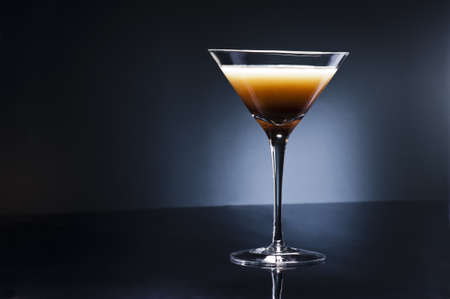 Coffee Martini cocktail in front of disco lights