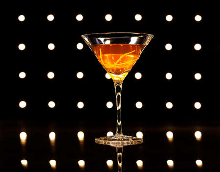 sweet vermouth: Manhattan cocktail in front of disco lights Stock Photo