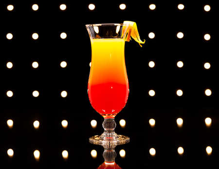 grenadine: Tequila Sunrise cocktail in front of Disco lights