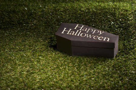 horrific: Halloween coffin on lawn with letters Happy Halloween