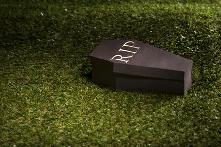 coffins: Halloween coffin on lawn with letters RIP Stock Photo