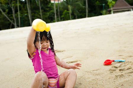 curios: Young toddler at the beach having fun and is curios