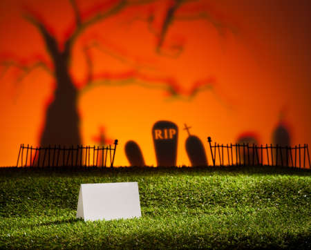 Halloween landscape with tree graveyard and name card
