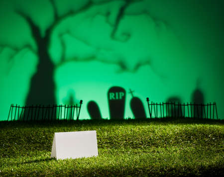 horrific: Halloween landscape with tree graveyard and name card