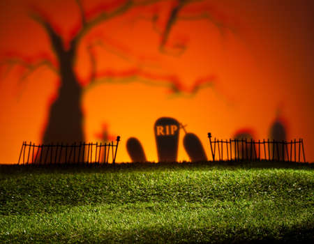 Halloween colorful landscape with tree and graveyard photo