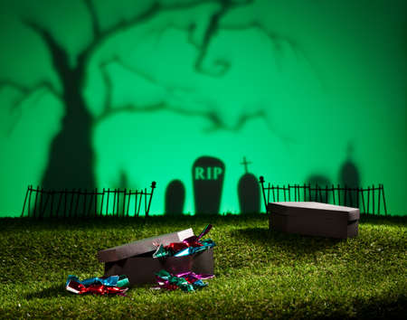 Halloween landscape with tree graveyard and sweets photo