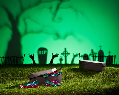 horrific: Halloween coffin on lawn with sweets and candies