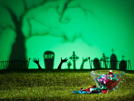 coffins: Halloween landscape with tree graveyard and sweets
