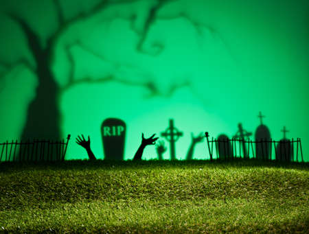 horrific: Halloween landscape with tree graveyard and green grass