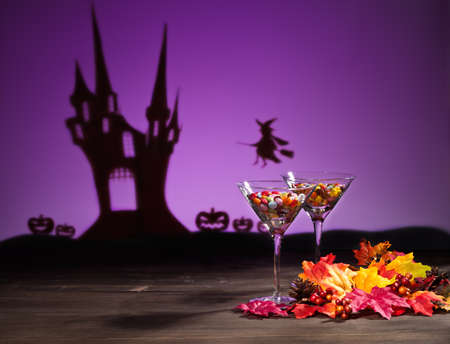 Halloween haunted house a witch and sweets photo