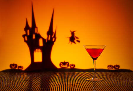 Halloween haunted house witch and a Cosmopolitan cocktail photo