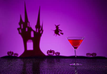 glass house: Halloween haunted house witch and a Cosmopolitan cocktail