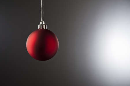 side lighting: Christmas Bauble in simple color setting and side lighting  Stock Photo