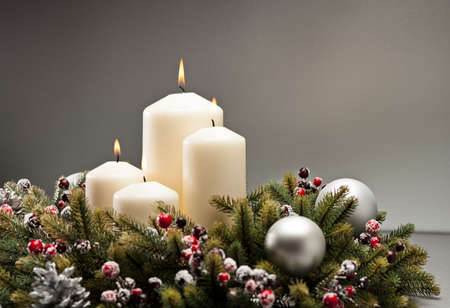 pine wreath: Advent wreath with burning candles for the pre Christmas time