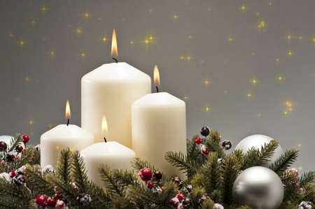 holly berry: Advent wreath with burning candles for the pre Christmas time