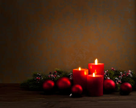 Advent Christmas wreath in front of dark moody background  photo